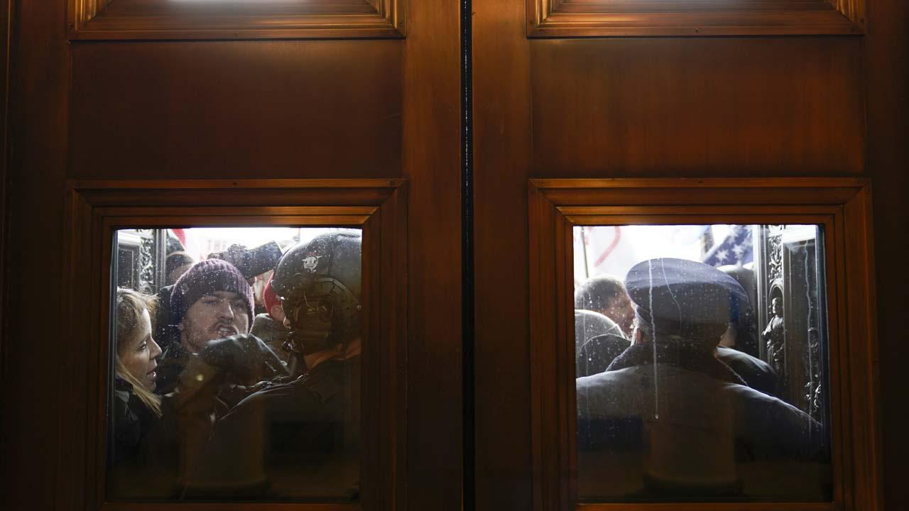 Protestors at the doors of the U.S. Capitol.